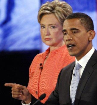 New York Senator Hillary Clinton (L) lis